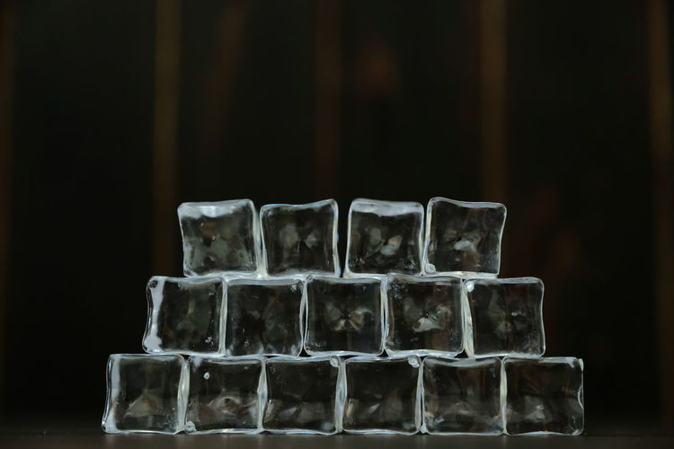Close-up of ice cubes on table