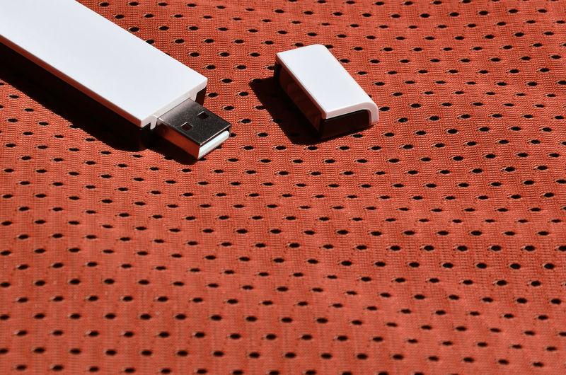 Close-up of usb stick on fabric