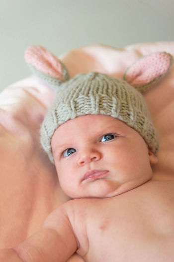 Close-up of cute baby girl wearing rabbit hat