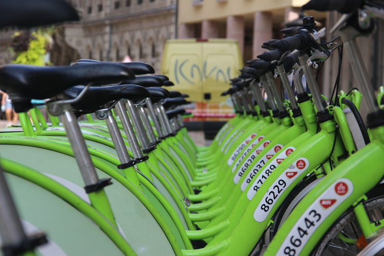 Close-up of bicycles in rack at market