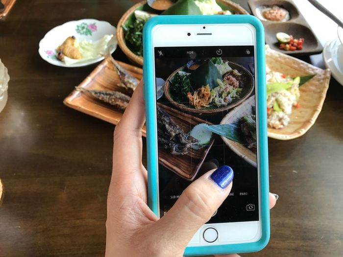 Taking photos. Human Hand Portable Information Device Technology Wireless Technology High Angle View Close-up Touch Screen Mobile Phone Food One Person Taking Photo Communication Using Mobile Device My World Of Food Local Delicacies SabahanFood Foodphotography Food Photography