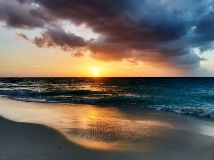 Relaxation Summer Island Caribbean Sea Horizon Over Water Beach Water Scenics Beauty In Nature Sunset Sky Tranquil Scene Nature Cloud - Sky Tranquility Idyllic Sand Reflection No People Outdoors Wave Vacations Day