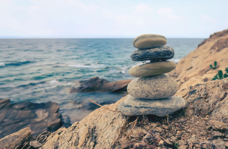 Stone balancing Sea Water Harmony Nature Landscape Yoga Outdoors Rock Tranquility Zen Peaceful Horizon Stacked Balance Close-up Stack Pebble No People Buddism Horizon Over Water Rock - Object Stone - Object Zen-like Stack Rock Scenics - Nature Solid Sky Beach Beauty In Nature Stacked Stones