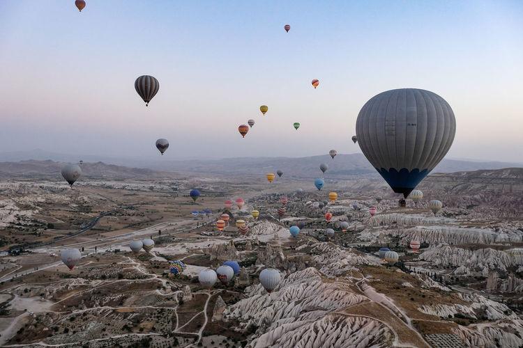 Hot air balloons over Cappadocia Cappadocia Hot Air Balloons Morning Turkey Balloon Cappadocia Ballon Cappadocia Hot Air Ballons Flying Hot Air Balloon Hot Air Ballooning Landscape Mid-air Nature No People Outdoors Sky