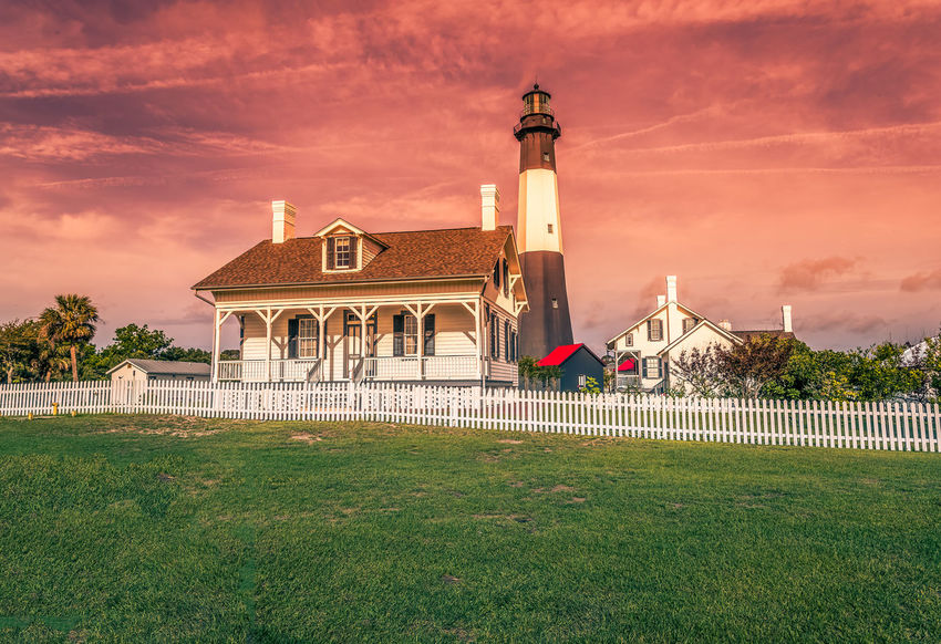 Tybee Island Lighthouse at Sunset Architecture Building Exterior Built Structure Cloud - Sky Day Grass Nature No People Outdoors Religion Sky Spirituality Travel Destinations Tree