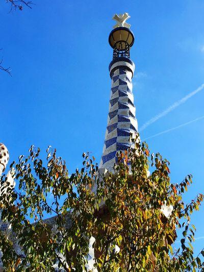 Parc Guell Barcelona Gaudi Gaudì Architecture Work Blue And White Mosiac Soaking Up The Sun Enjoying The Sun On Holiday Eyeem Barcelona EyeEm Best Shots Blue Sky Trees And Sky Holiday Memories Holiday In Barcelona Gaudi Barcelona Barcelonagramers Gaudi #barcelona
