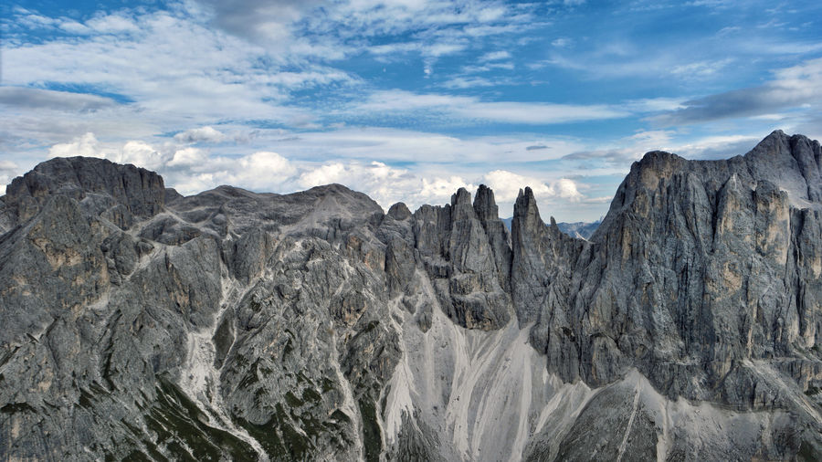 Mountain Sky Cloud - Sky Scenics - Nature Environment Rock Landscape Beauty In Nature Nature Mountain Range Remote No People Non-urban Scene Formation Tranquil Scene Rock Formation Day Tranquility Outdoors Rock - Object Mountain Peak Climate Arid Climate Vajolet Dolomites, Italy