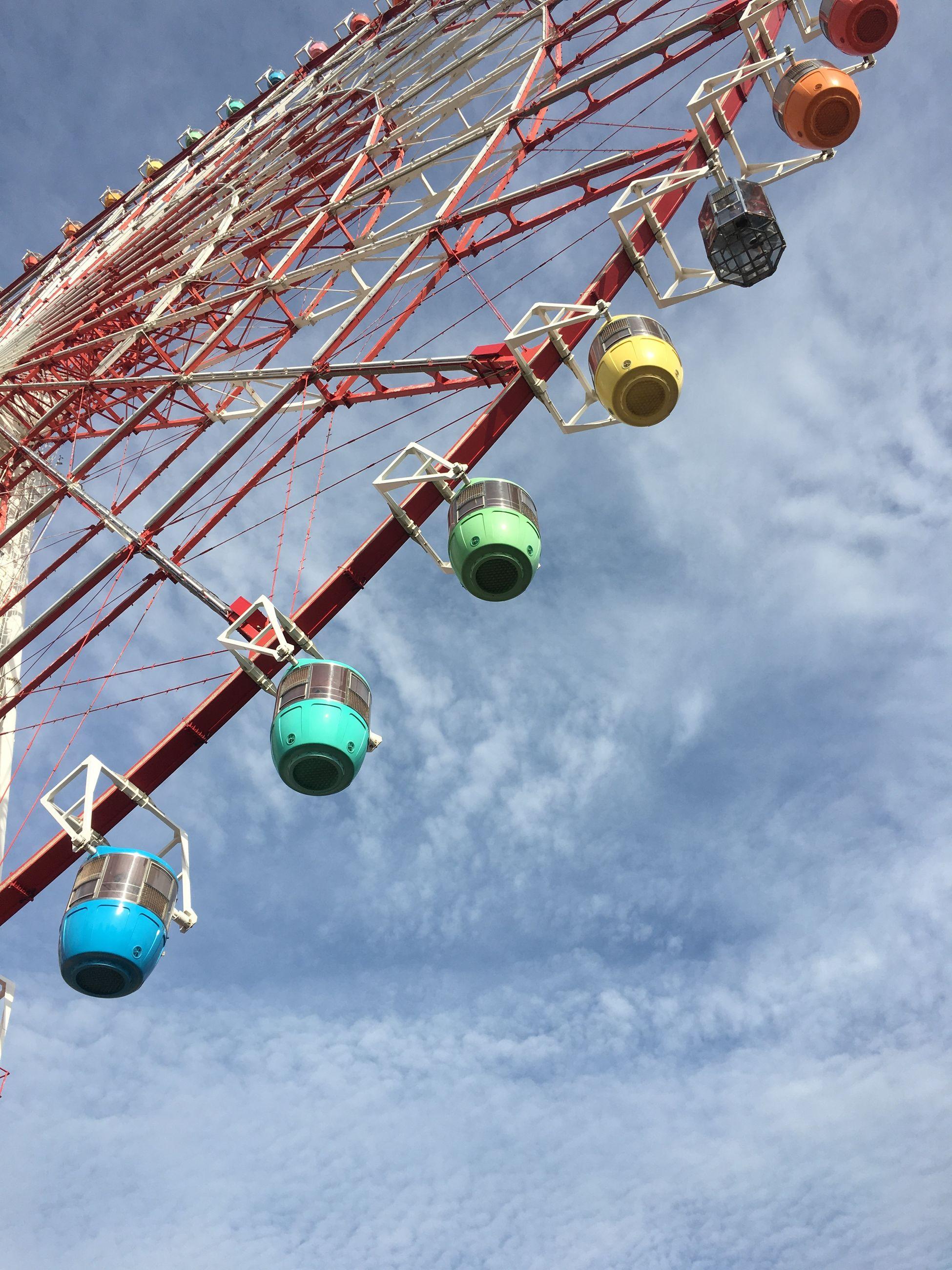 low angle view, sky, amusement park, amusement park ride, arts culture and entertainment, cloud - sky, nature, day, ferris wheel, outdoors, enjoyment, no people, fun, fairground, leisure activity, hanging, multi colored, carnival, metal, decoration, excitement