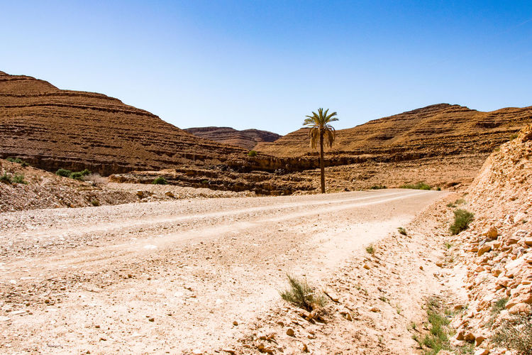 lonely alone. Close to Amtoudi Desert Arid Climate Sand Clear Sky Nature Mountain Scenics Sky Outdoors Mountain Range Landscape Blue Day No People Beauty In Nature