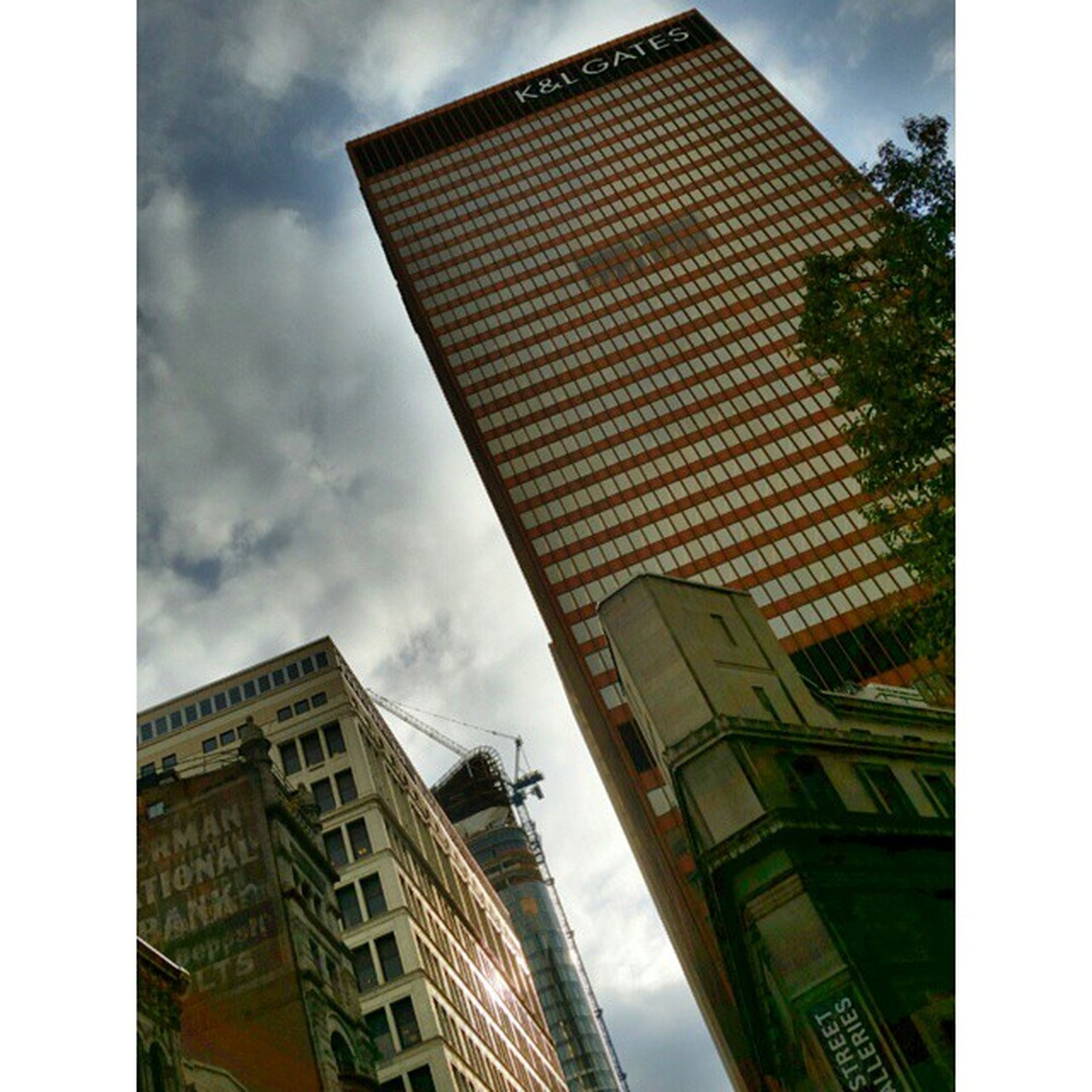 architecture, building exterior, built structure, sky, low angle view, city, modern, office building, skyscraper, tall - high, tower, cloud - sky, building, reflection, cloud, glass - material, auto post production filter, transfer print, cloudy, tall