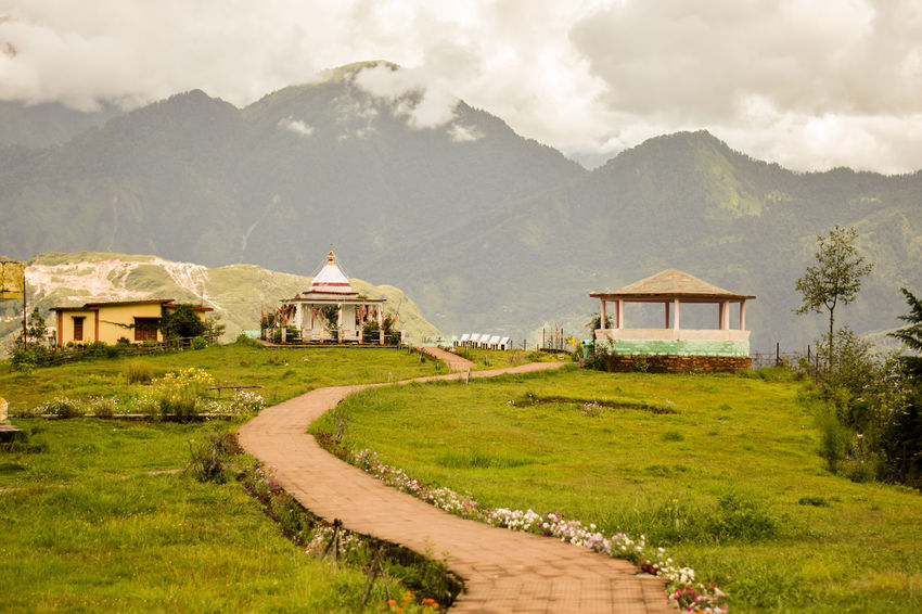 beautiful view of Nanda Devi Temple, Munsyari (Uttarakhand) Trekking Munsyari Uttarakhand Incredible India Religion Religious Place Pathway Beauty In Nature Grass Landscape Mountain Mountain Range Nanda Devi Temple Nature No People Outdoors Scenics Sky Temple Tranquility Walkway Spirituality Temple - Building Lush - Description Place Of Worship