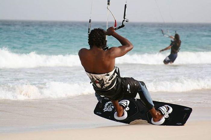 Kitesurfer touches the sand EEprojects LiveTravelChannel Canon_photos Snapzone Sun Summer Wakeboard Jetski Beach Beachwear Bay Rich Tourism Travel Sport Powerboat Ride Wave Holiday Destination Extremesports Yacht Turquoise Sea @natgeotravel Tropical travel kitesurf surf @riderschannelskillstravelawesome