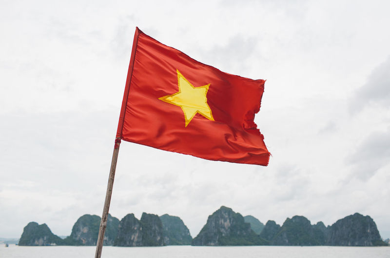 Vietnamese flag waving against sky