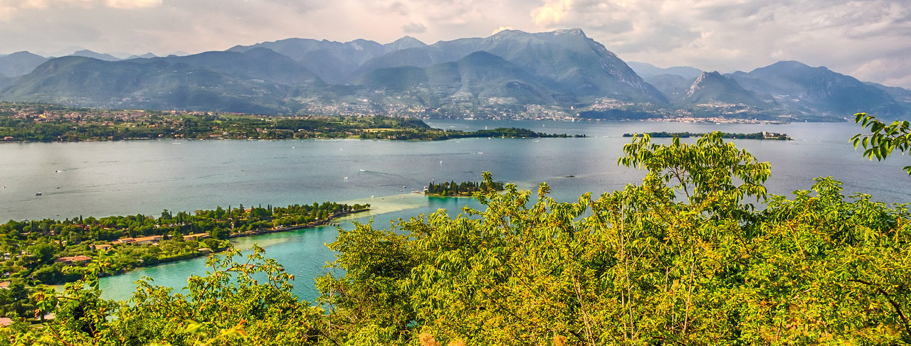 Panoramic aerial view from the Manerba Rock on Lake Garda, Italy Water Mountain Scenics - Nature Beauty In Nature Sky Tranquility Tranquil Scene Plant Mountain Range Nature Cloud - Sky Tree Lake No People Non-urban Scene Growth Day Outdoors Idyllic