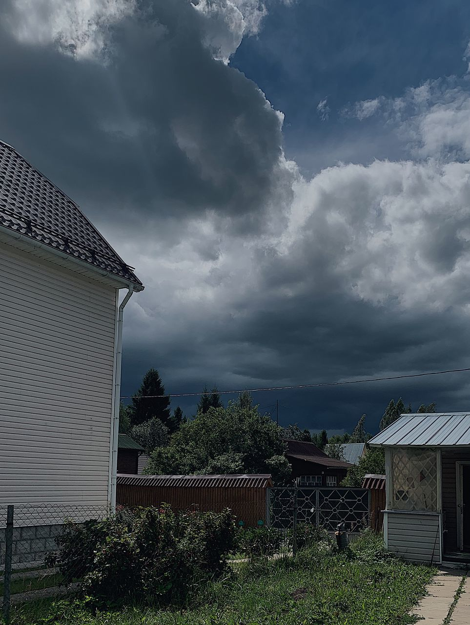 cloud - sky, architecture, building exterior, built structure, sky, building, house, nature, roof, plant, no people, day, tree, residential district, outdoors, storm cloud, storm, overcast, land, ominous, roof tile