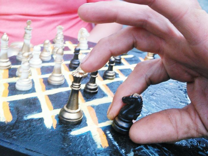 Chess Chess Board Chess Piece Game Competition Playing Playing Games Playing Chess Human Hand Arts Culture And Entertainment Strategy People Competitive People Watching Bar Games Coffee Shop Chillin' Brain Game Chessboard Bookstore Bookshop Public Art Leisure Games Community Fun With Friends
