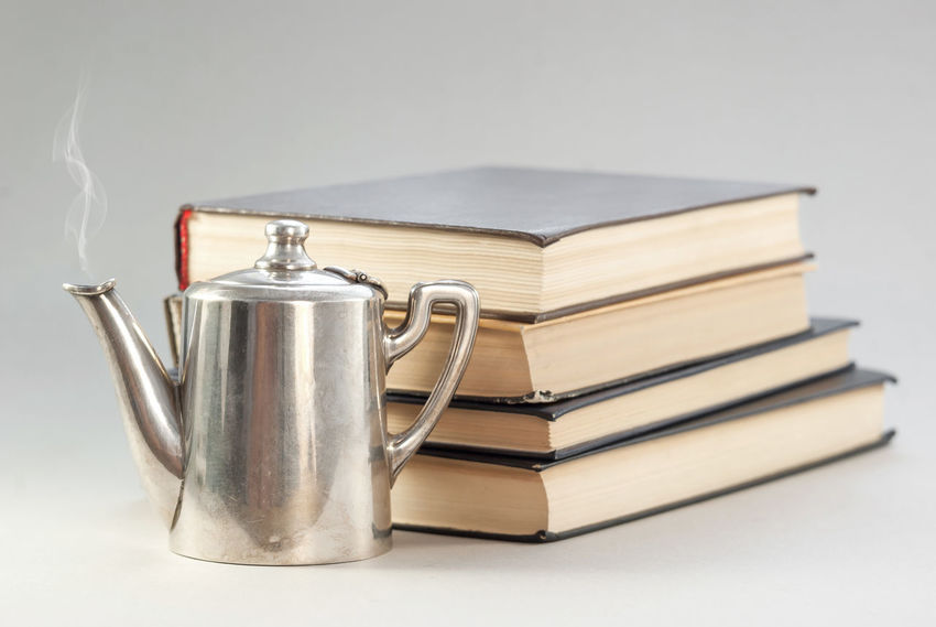Book Close-up Copy Space Cup Cut Out Education Focus On Foreground Food And Drink Group Of Objects Hardcover Book Indoors  Large Group Of Objects Metal No People Publication Silver Colored Single Object Stack Still Life Studio Shot Table White Background