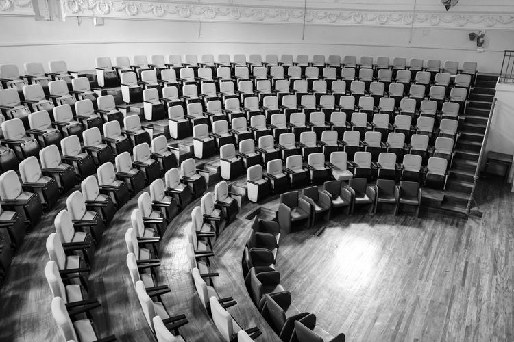 Arts Culture And Entertainment Auditorium Chair Day Film Industry In A Row Indoors  Large Group Of Objects No People Seat