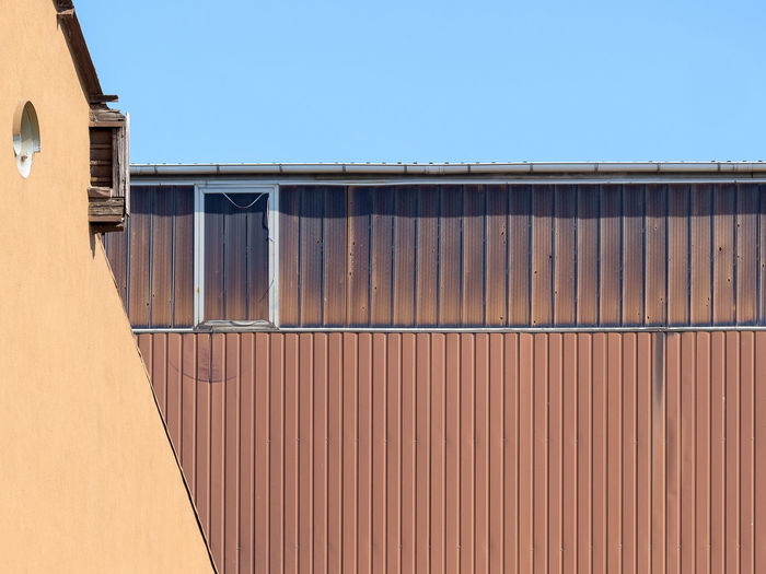 Architecture Blue Building Building Exterior Built Structure Clear Sky Copy Space Corrugated Day Industry Iron Low Angle View Metal Nature No People Outdoors Residential District Sky Sunlight Wall - Building Feature Window