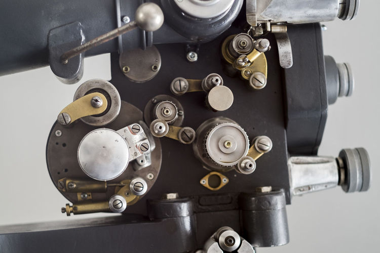Close-Up Of Vintage Movie Camera Against Wall