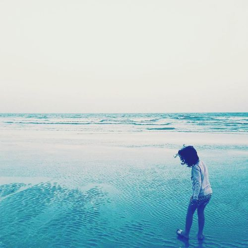 Sea Beach Water Horizon Over Water Tranquility Standing Beauty In Nature Tranquil Scene Scenics One Person Rear View Outdoors Nature Vacations Real People Sky Weekend Activities Full Length Sand Summer Girl Journey Childhood One Girl Only Young