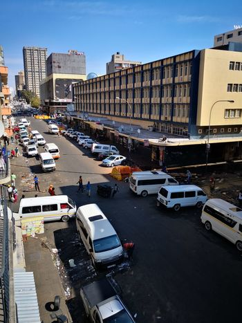 Johannesburg Taxis Minibuses Taxi City Cityscape Water Politics And Government Architecture Building Exterior Sky Vehicle Urban Skyline