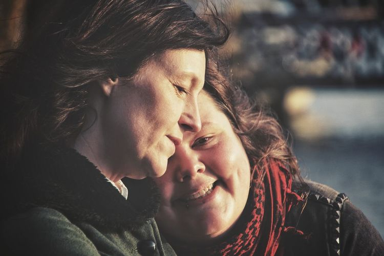 Close-up of lesbian couple outdoors