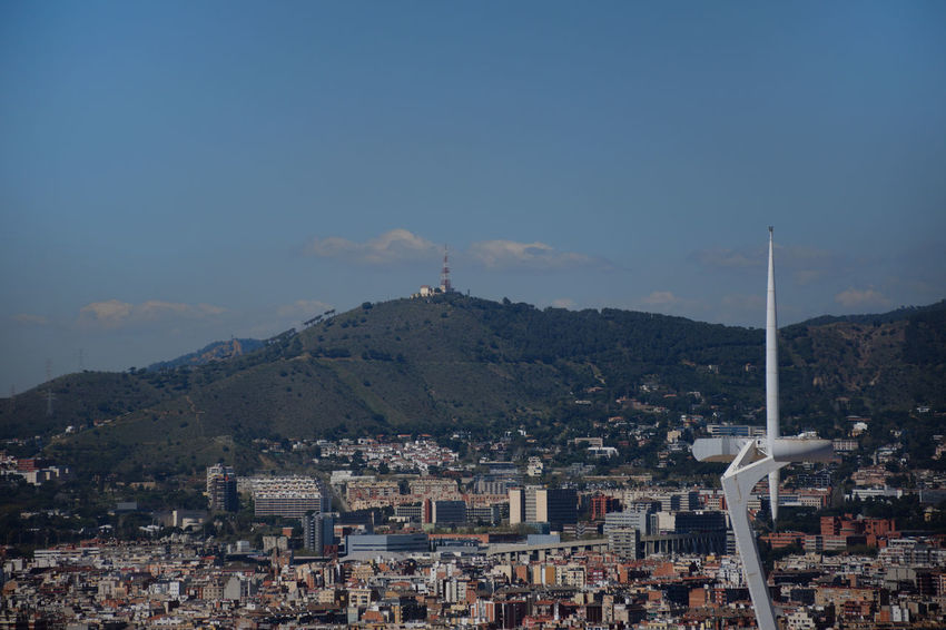 Antenna tower with barcelona city Barcelona Antenna Architecture Building Building Exterior Built Structure City Cityscape Crowd Crowded Europe Mountain Outdoors Residential District Sky Urban