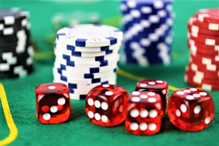 Close-Up Of Gambling Chip On Casino Table