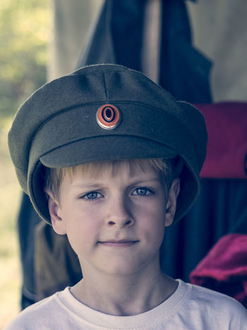 Little Caucasian boy in cap officer of the White Army during the Civil War 1917 - 1921 in the Russian Empire 1917 1921 Army Boy Boys Cap Caucasian Childhood Civil Close-up Cute Elementary Age Empire Focus On Foreground Front View Hat Headshot Innocence Little Looking At Camera Officer Person Russian War White