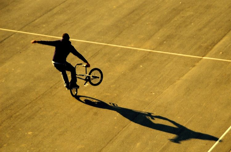 Freedom Concentration Court Focus High Angle View Leisure Activity Outdoors Real People Shadow Silhoutte Skill  Sport Stuntbikes Young Guy
