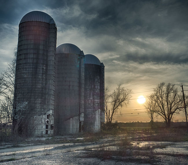 Abandoned Farm Abandonded Abandoned Farm Architecture Building Exterior Built Structure Farm Ominous Sky Rural Rural Scene Silos Stormclouds Sunset Twister Vanishing Farms Wizard Of Oz