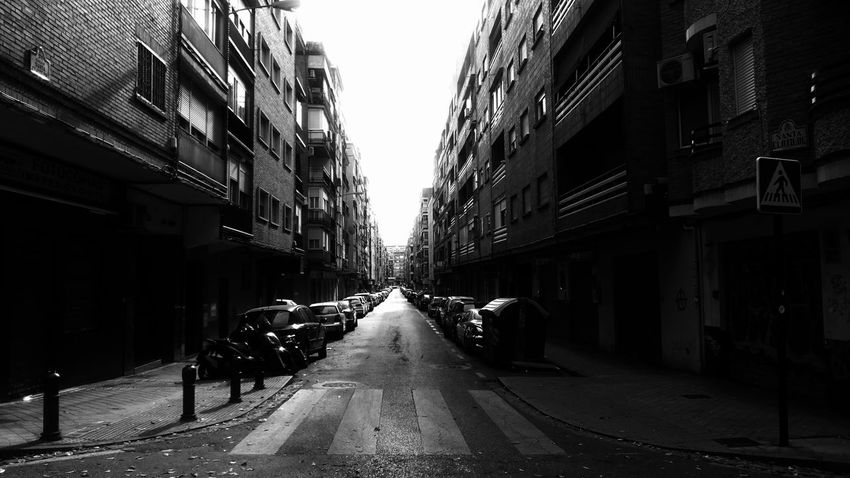 Architecture Building Exterior City Built Structure Street The Way Forward Direction Building Residential District Transportation Sky Mode Of Transportation Diminishing Perspective Day Motor Vehicle Incidental People Land Vehicle Car Road Nature Outdoors Alley Blackandwhite Monochrome