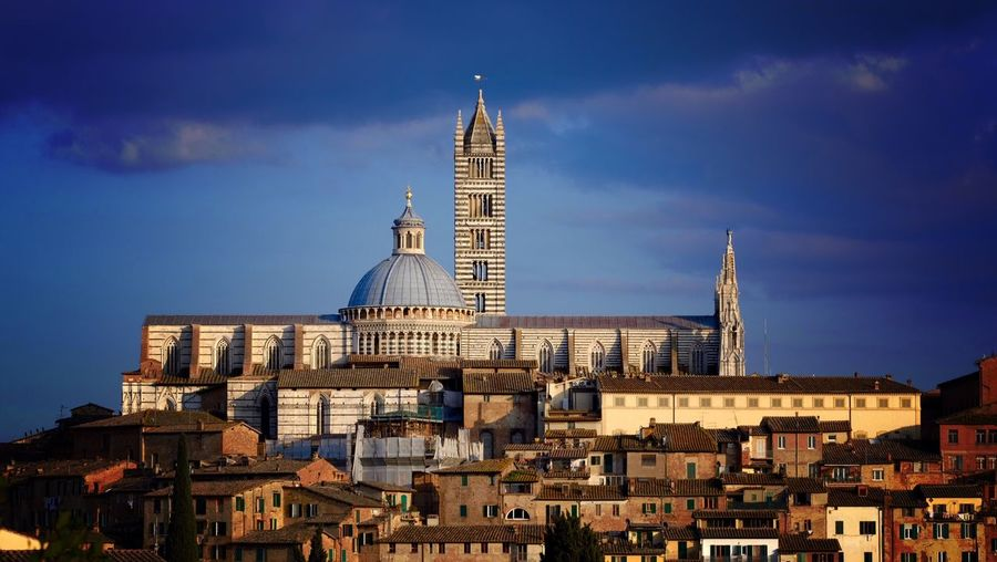 Low Angle View Of Siena Cathedral Against Blue Sky