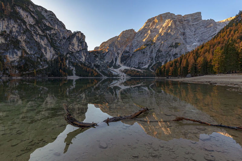 Reflection of mountain in lake at lago di braies in dolomites mountains