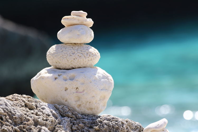 Close-Up Of Stone Stack On Rock At Shore