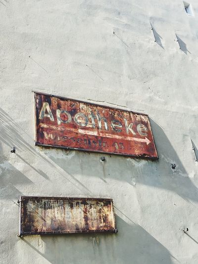 Damaged Day Rusty Abandoned Metal Text Outdoors Weathered No People Run-down Architecture Built Structure Communication Low Angle View Building Exterior Apotheke Berlin Rusted