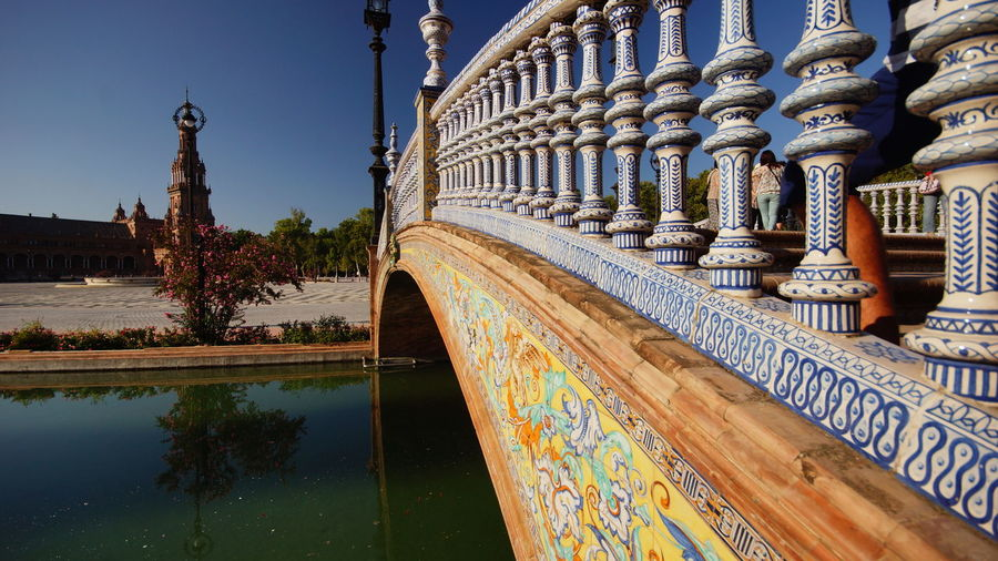 Footbridge Over Pond Against Sky At Plaza De Espana