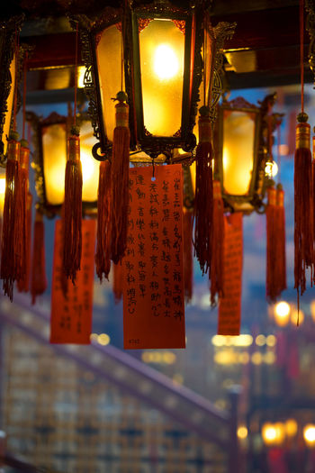 Hanging Lighting Equipment Illuminated No People Lantern Indoors  Religion Architecture Decoration Selective Focus Close-up Focus On Foreground Light Electric Lamp Temple Temple - Building Temple Architecture Temples Red Red Color Lanterns Religious  Luminosity Light And Shadow Lights
