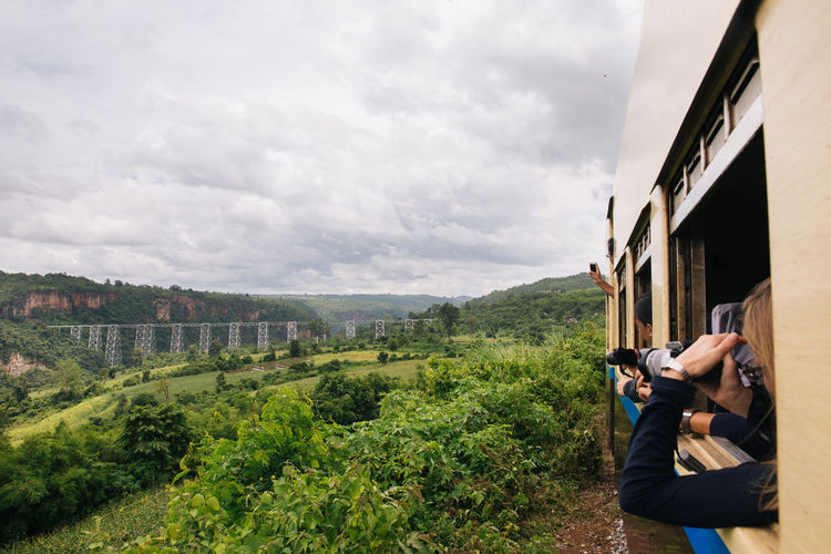 """Everybody knows that it's not safe to have your head outside of window on the moving train, but you do it anyways. Nobody can resist to see the beautiful view from """"Goteik viaduct"""", the highest bridge and the largest railway trestle in Myanmar. Burma Cloudy Gohteik Viaduct Goteik Viaduct Landscape Maymyo Myanmar On The Train On The Way Railway Railway Track Railway Trestle Shan State Southeastasia Train Traveling Burmese Train Showcase July My Year My View Miles Away"""