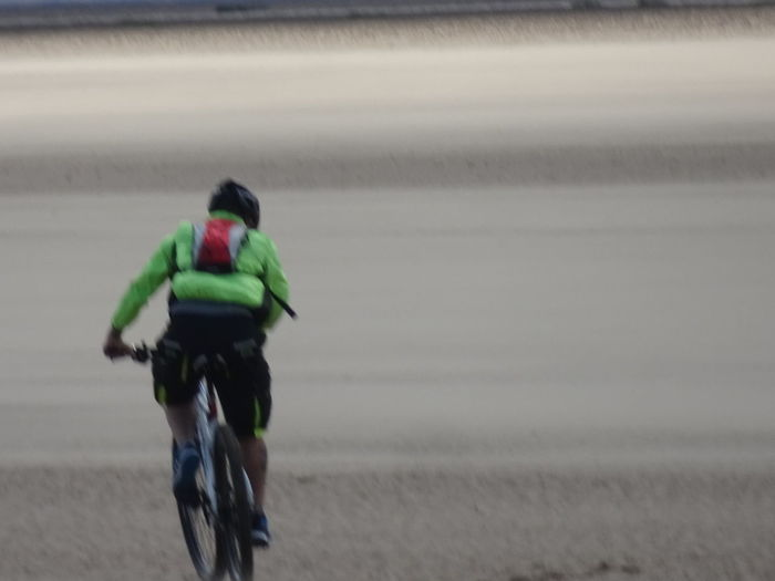 Rear View Cycling On Beach One Person Leisureride Beach Adult Day