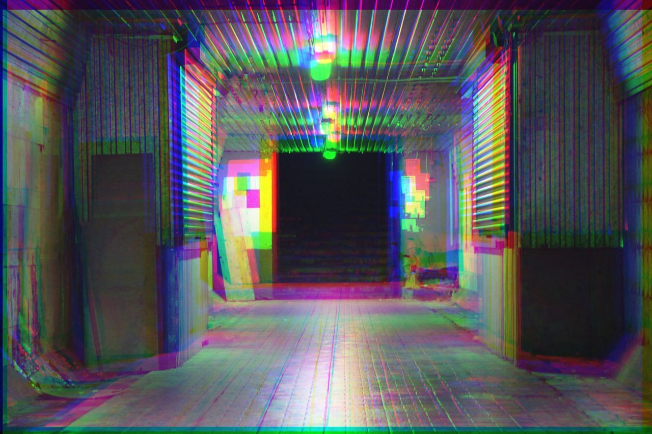 multi colored, architecture, indoors, built structure, direction, no people, the way forward, illuminated, building, arcade, corridor, lighting equipment, pattern, empty, flooring, day, footpath, diminishing perspective, creativity, ceiling, long