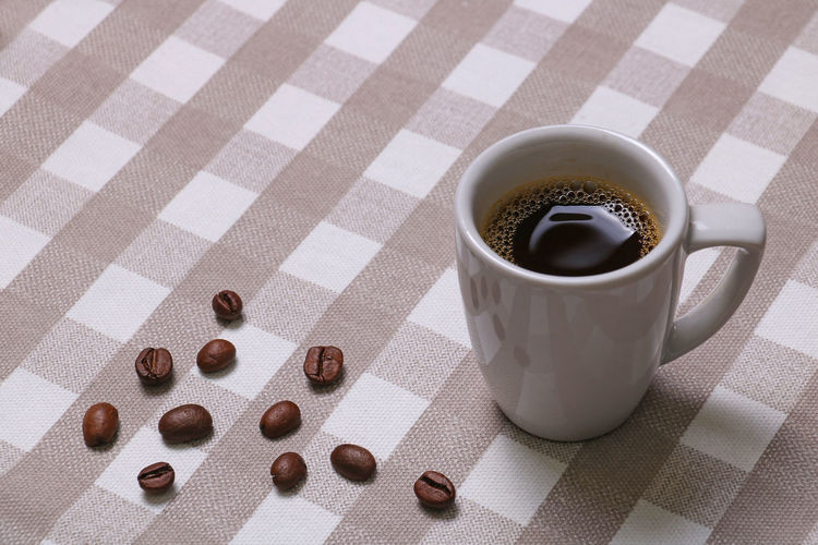 Tablecloth Food And Drink Drink Cup Indoors  Mug Refreshment Table Coffee Cup Food Coffee - Drink No People Coffee High Angle View Still Life Freshness Close-up Checked Pattern Shadow Crockery Copy Space Espresso Black Coffee Coffee Beans Good Morning! Freshness