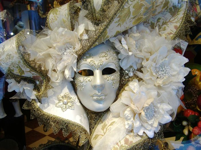 Close-up of carnival mask at window display