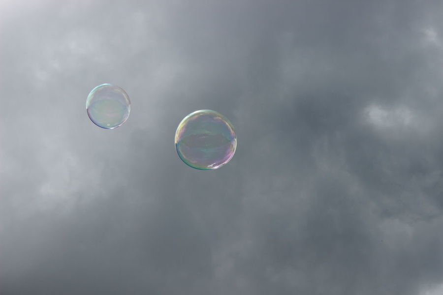 Dreams & Bubbles flying high Beauty In Nature Bubble Bubble Wand Cloud - Sky Day Double Rainbow Fragility Low Angle View Mid-air Nature No People Outdoors Rainbow Sky Soap Sud Spectrum