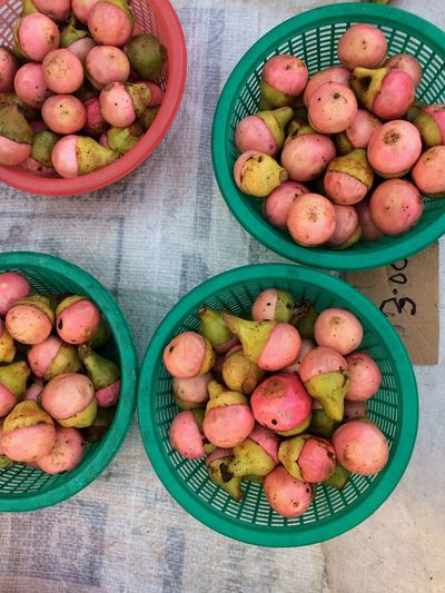 Buah engkala from Borneo Island Pink Exotic Borneo Wet Market Outdoors Basket Food And Drink Healthy Eating High Angle View Variation Directly Above Fruit Food Green Color Choice Table For Sale Freshness Large Group Of Objects No People Day Indoors  Close-up Food Stories