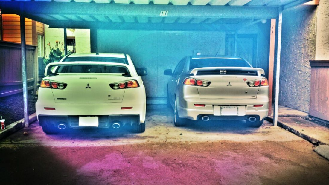 Dad's ralliart(right). Son's evo (left) Relaxing Check This Out Hi!