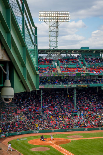 Boston Red Sox playing a day game at Fenway Park Group Of People Sport Crowd Stadium Spectator Large Group Of People Architecture Real People Seat Outdoors Grass Nature Built Structure Team Sport Sky Competition Building Exterior Day Watching Baseball Fenway Park Fenwaypark Boston Red Sox Xander