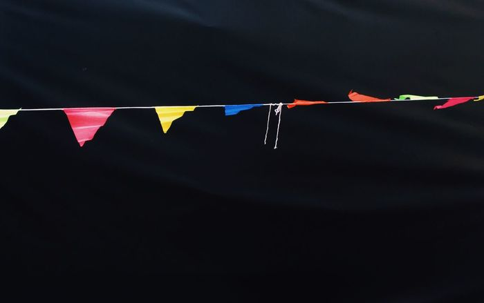 .. Black Background Black Celebration Pattern Communication Detail Colorful Colorsplash Colors The Graphic City Flag Hanging No People Close-up Celebration Multi Colored Day Outdoors Colour Your Horizn