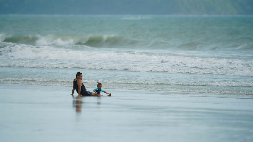Beach Father And Son Relaxation Sea Sitting Togetherness Tranquility Vacations Water Wave
